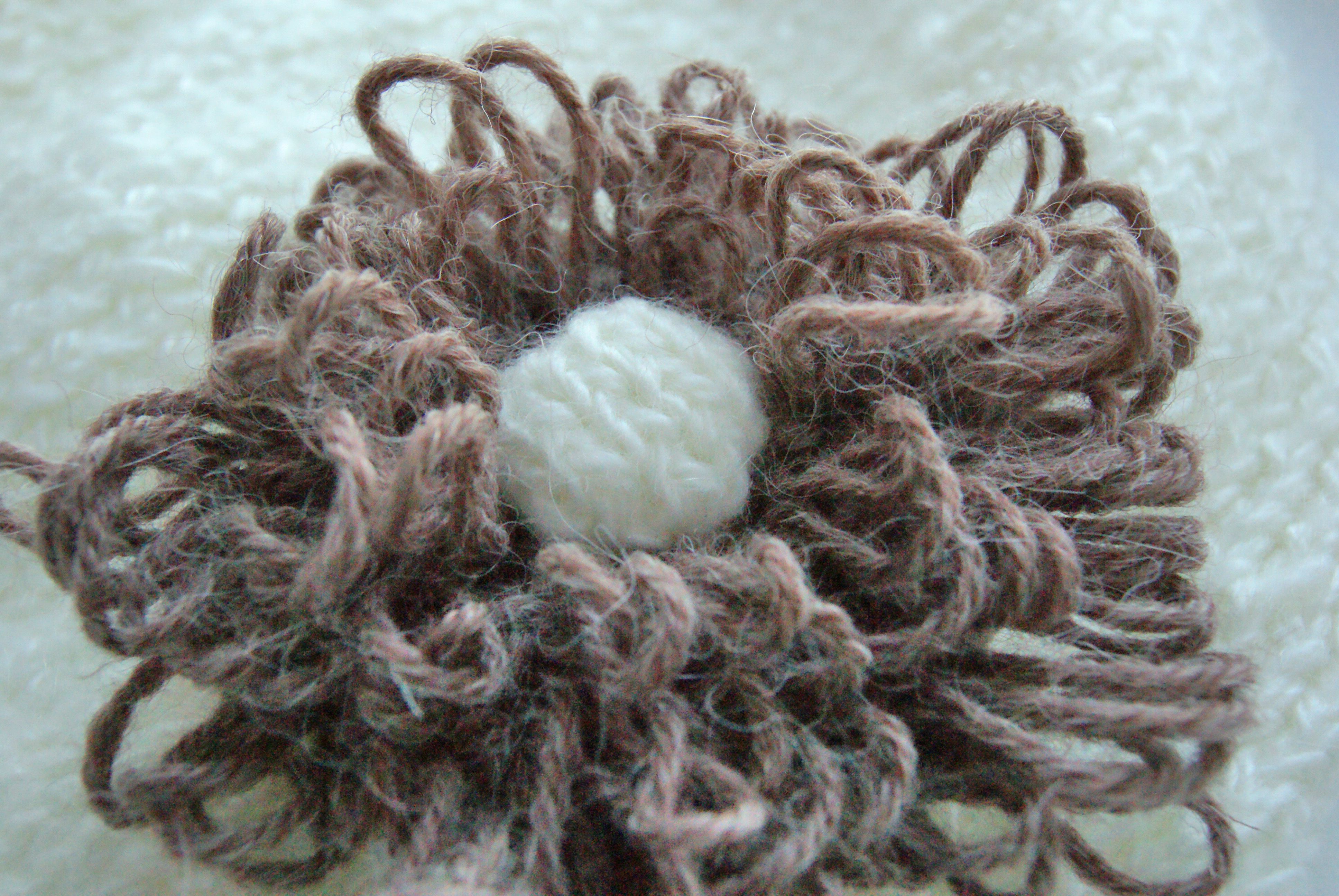 white clothes knitting hat flower