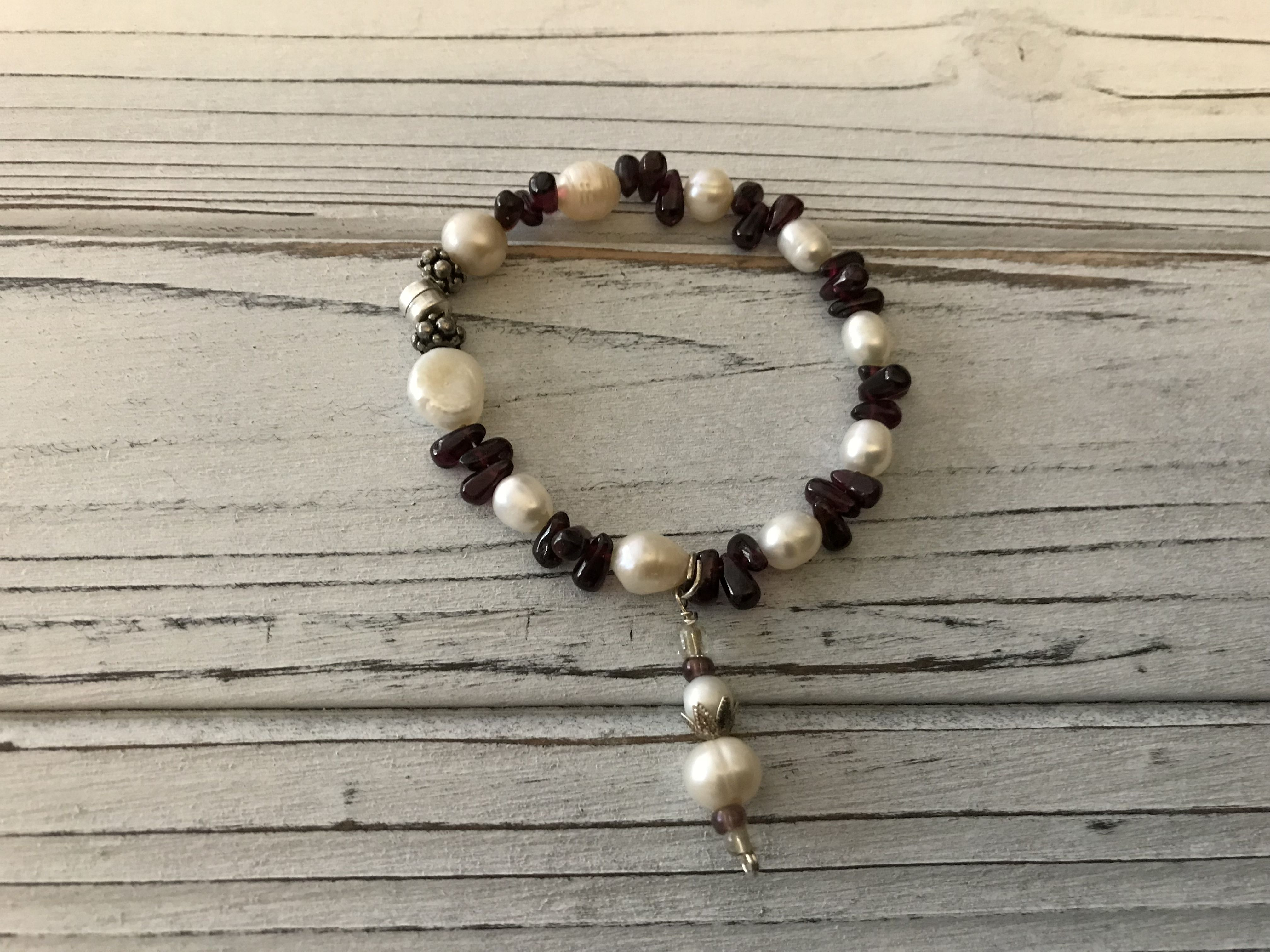 madewithlove loveandlight emotional cooltotouch lovepearls handmade confidence uniquebracelet magnetclasp garnet health