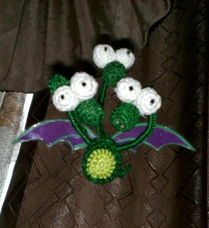 dragon toy green interior knitting