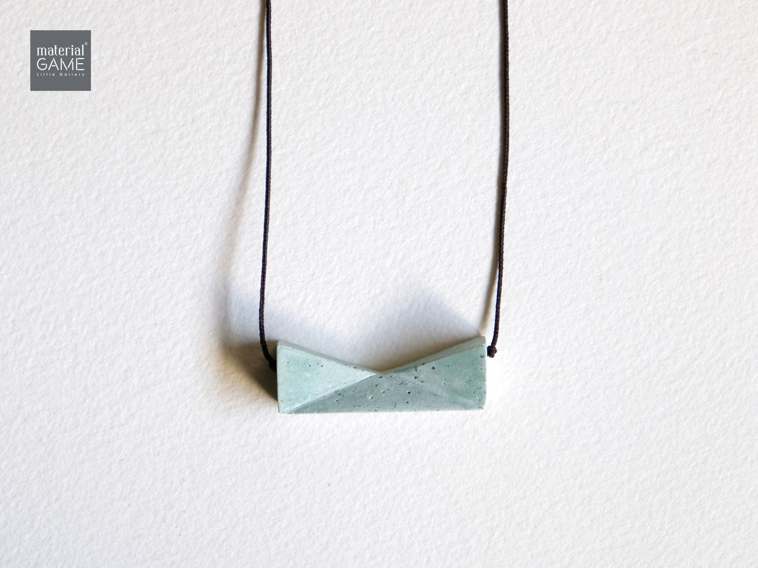mint green sliding concrete grey jewelry necklace geometric design