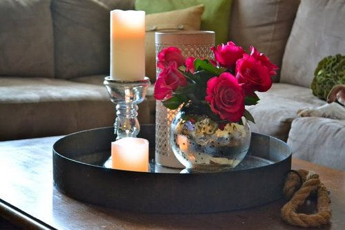 books flowers decorate candles coffee table