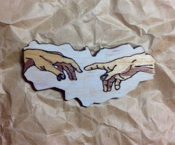 """The creation of Adam"" brooch"