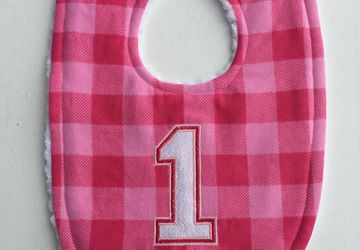 Pink buffalo plaid birthday bib for girls