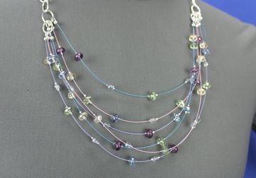Multi-strand necklace with floating, Czech fire-polished glass beads and silver plated chain