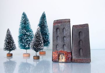 Black Ceramic raku art buildings with copper details