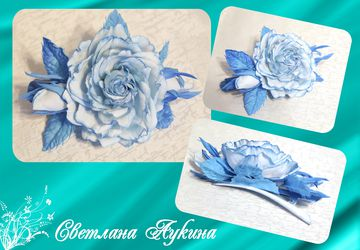 A hairpin with blue flowers