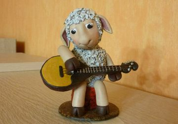 A sheep with a domra