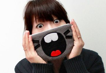 The TOTORO Mouth Zipper Coin or iPhone Purse