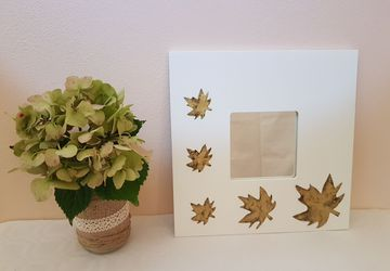Personalized mirror with antique gold colored leaves and transparent resin