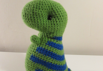 Green dinosaur with blue stripes