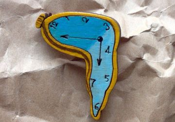 """Soft clocks"" brooch"
