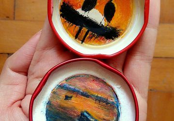 hand painted landscapes in bottle caps