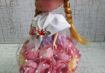FLOWER DRESSED DOLL, THE DOLL IN PINK