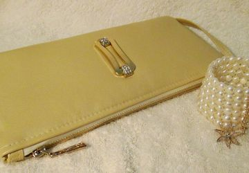 A golden leather clutch