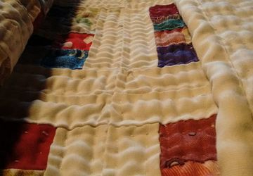 One Inch Postage Stamp Hand Sewn Quilt