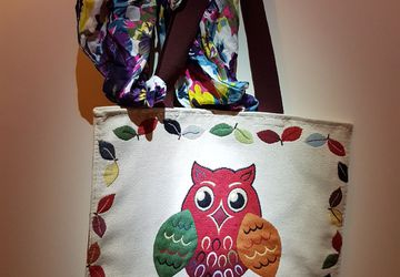 Handmade fabric bag with a colorful owl