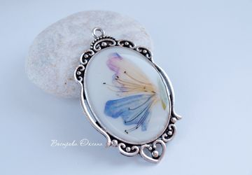 A pendant with a stylized butterfly