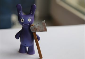 A ceramic bunny with an axe
