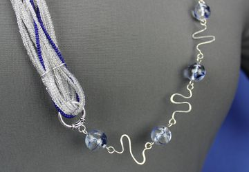 Unique asymmetrical glass bead necklace with wirework links, blue, clear, and silver