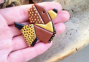 Origami style dog brooch made from polymer clay