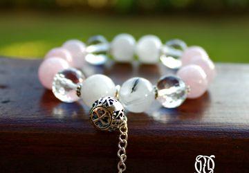 A wristlet with natural quartz on an elastic lace