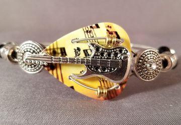 "Guitar Pick and Guitar String Bracelet ""Amber Guitar"""