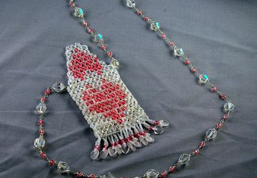 white with pink heart amulet bag