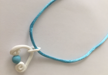 Minimalist Polymer Clay with blue beads in a blue Silk cord n. 007