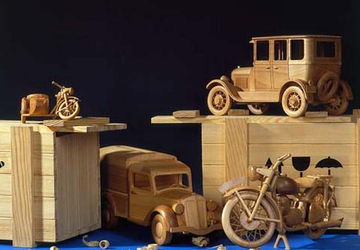 Wooden toy cars and a motorcycle