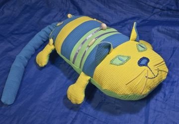 A pillow in a form of a cat