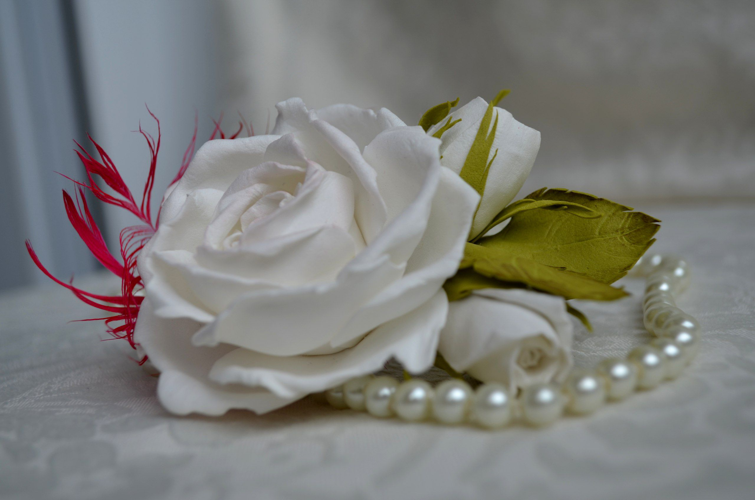 wedding rose pin hair hairstyle white